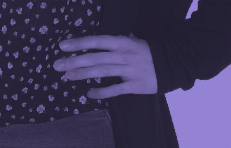 Image: prurple photo of a hand on someones waist