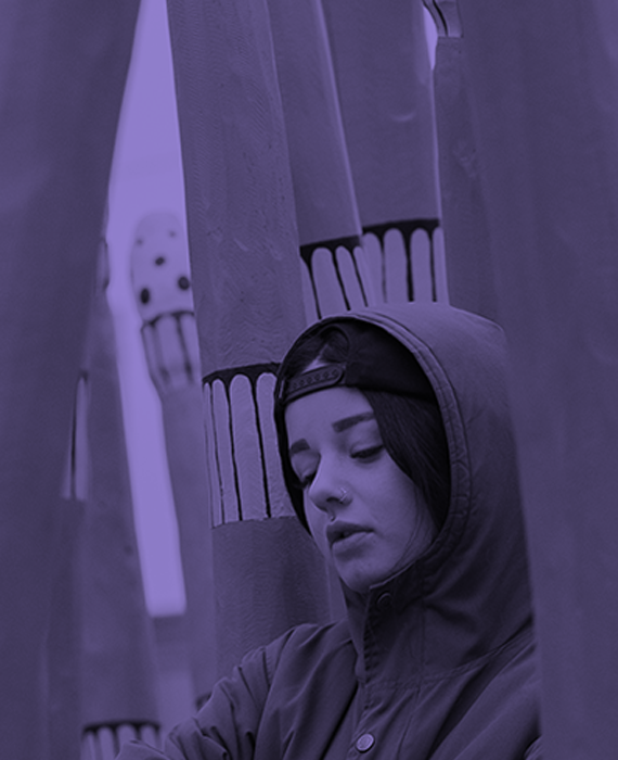 Image: Purple photo of a girl in a hoodie looking down